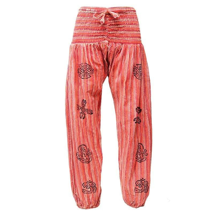 High crotch harems with elasticated waist and ankles in a stonewashed finish with block printed symbols and a drawstring adjustable waist - Orange