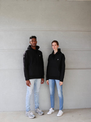 Edward Joiner models wearing hoodie