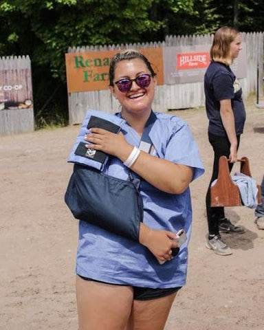Back at the horse show after being discharged from the hospital. Note the scrub shirt & ice boot shoulder compress.