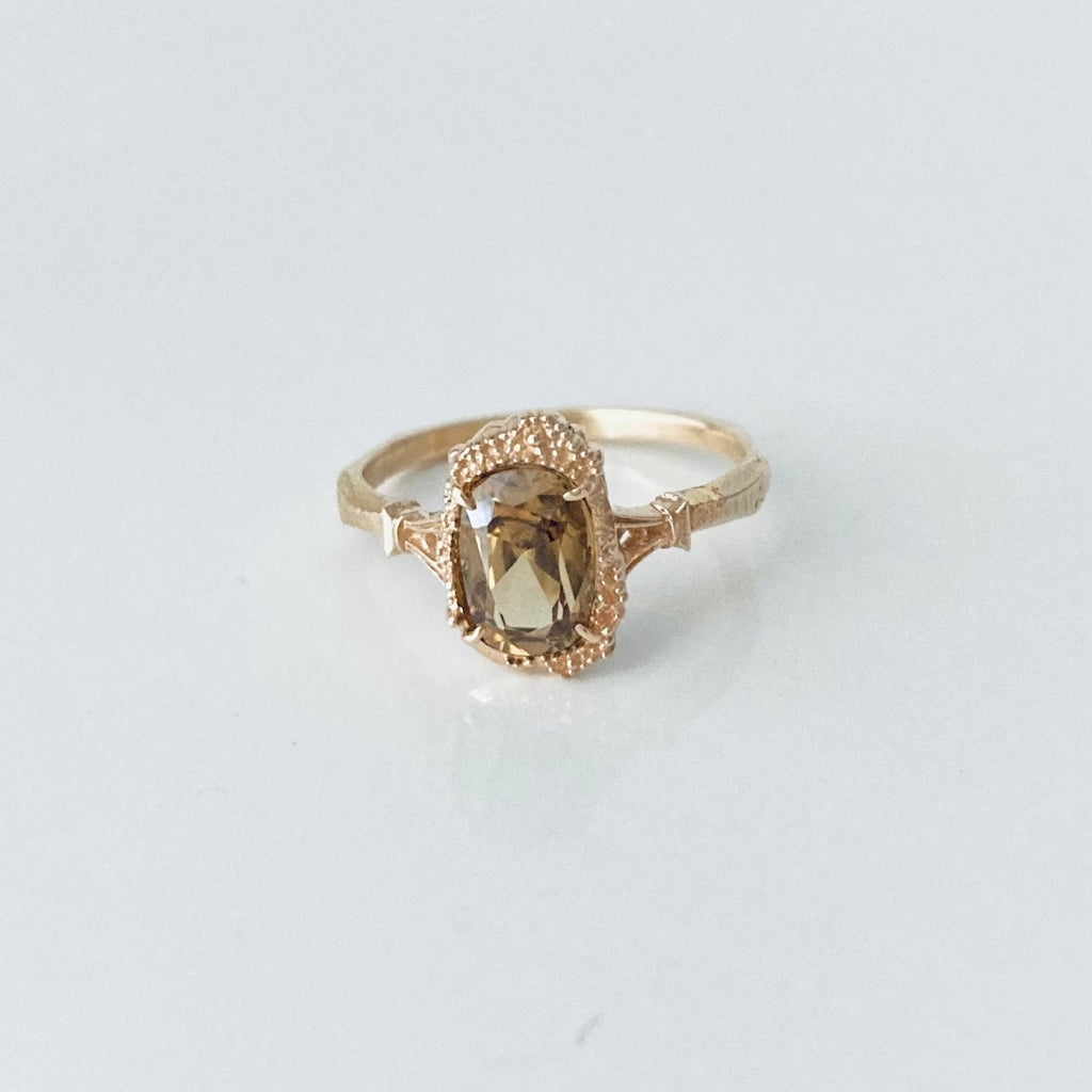 brown zircon ring