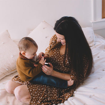 Mom playing with 10 month old baby