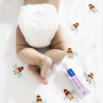 baby bottom with diaper and diaper cream
