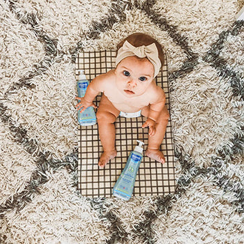 7 month old baby with mustela products