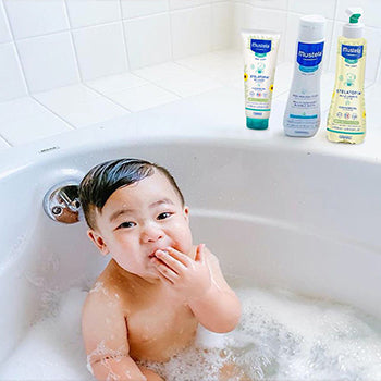 7 month old baby taking a bath
