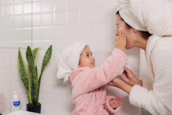 Mom and toddler caring for eczema-prone skin