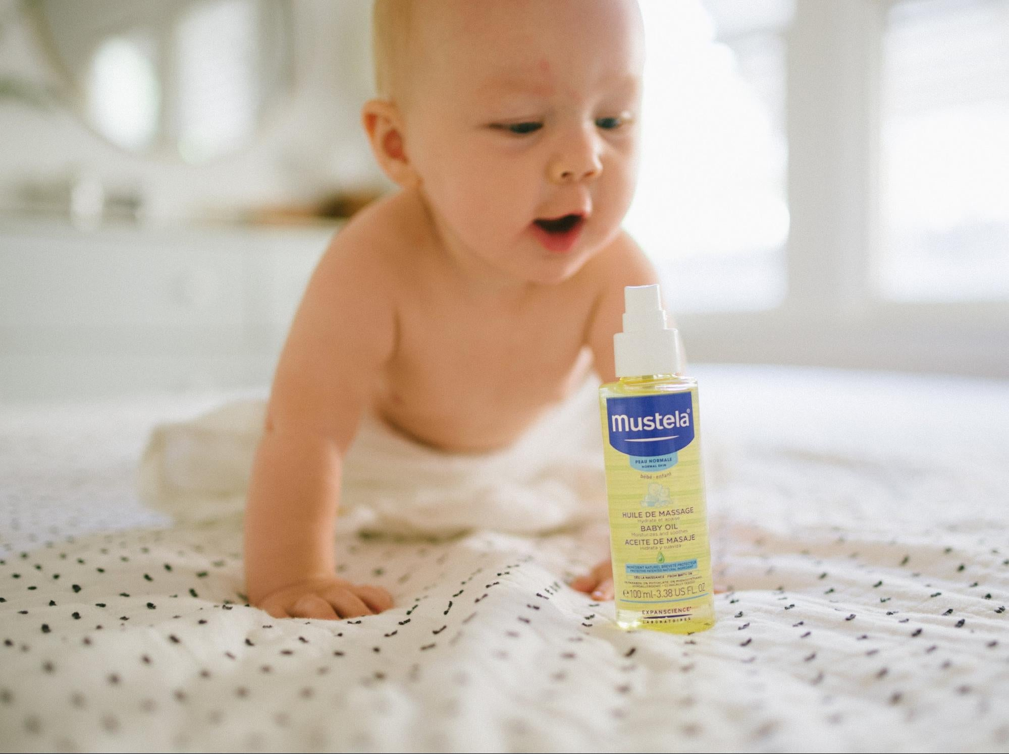 baby crawling to Mustela Baby Oil