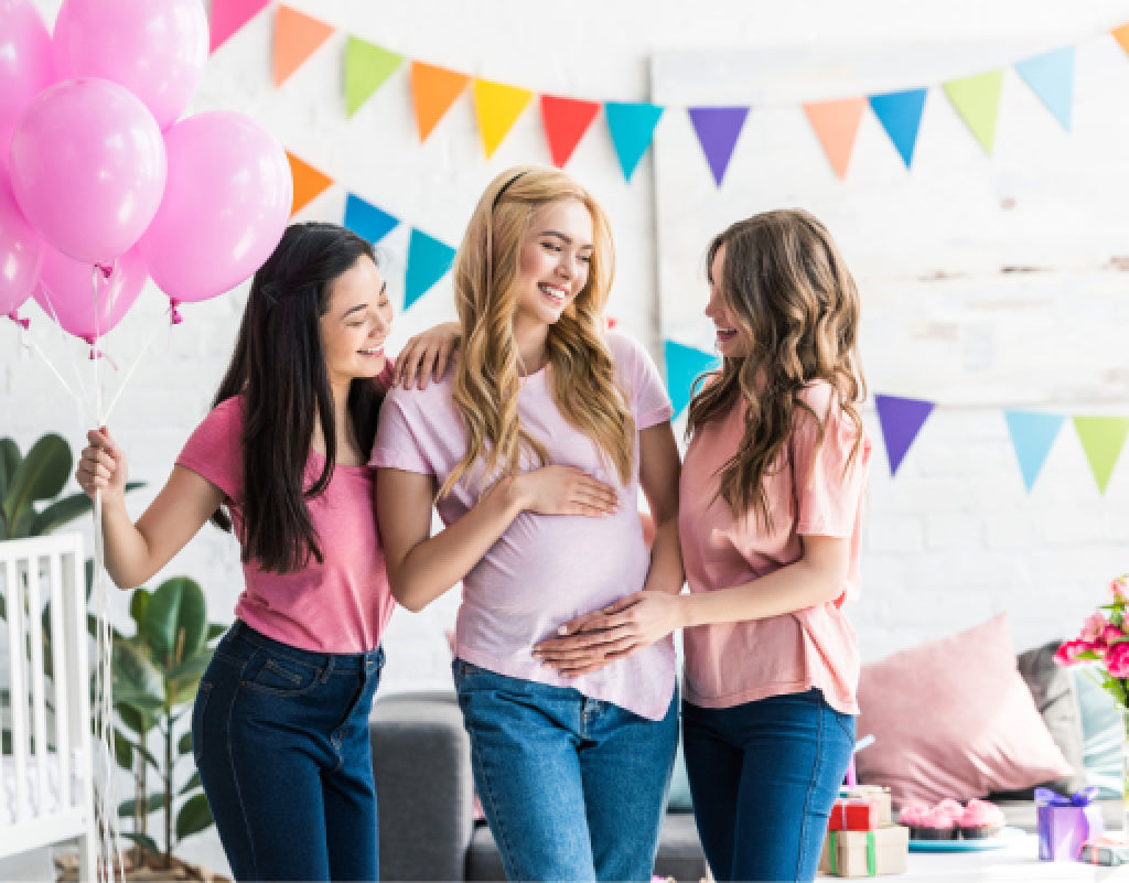 Pregnant woman with friends at her baby shower