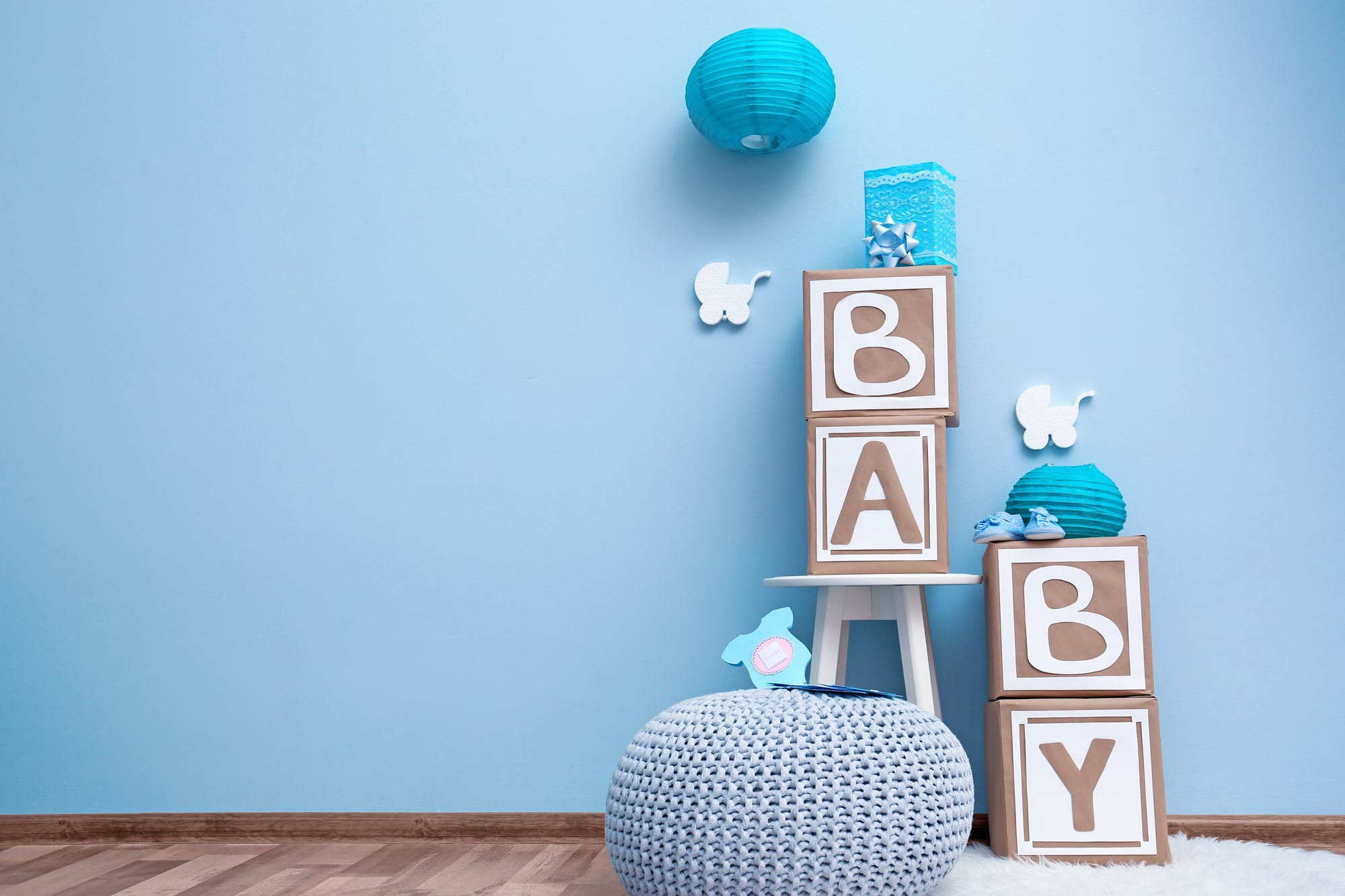baby block spelling baby in a blue room