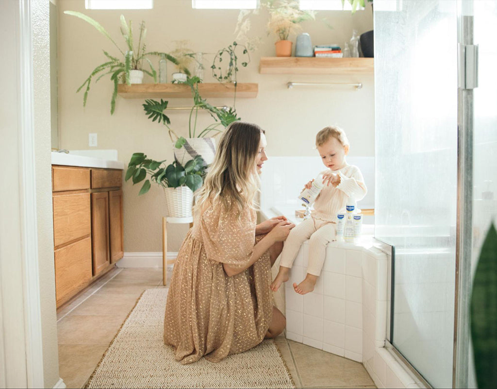 Mom setting baby up for a bath because baby wont nap
