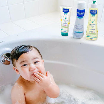 Baby taking a bath with Mustela products to soothe Childhood Eczema