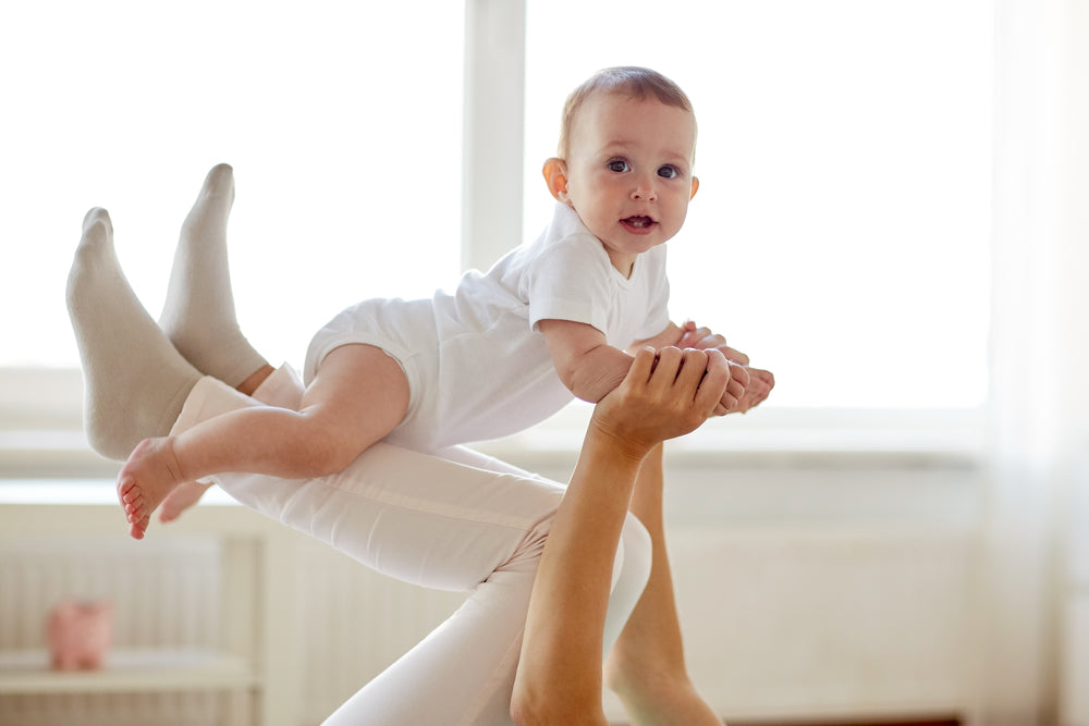mom and baby doing postpartum exercise