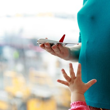 Woman flying with baby