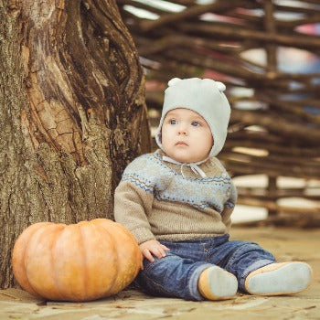 Child with eczema outside during the fall