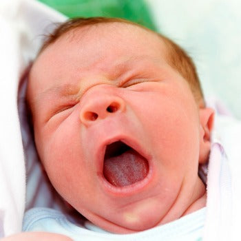 Baby crying with tongue-tie