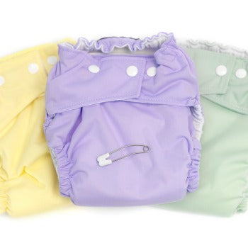 set of yellow, green, and purple pastel cloth diapers