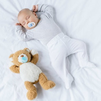 baby napping with teddy bear