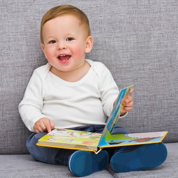 baby looking at pictures in a book to work on baby first words