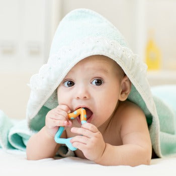 baby in towel playing