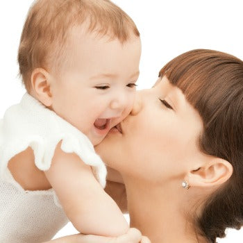 mother kissing happy baby