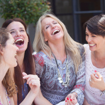 friends laughing at a baby shower