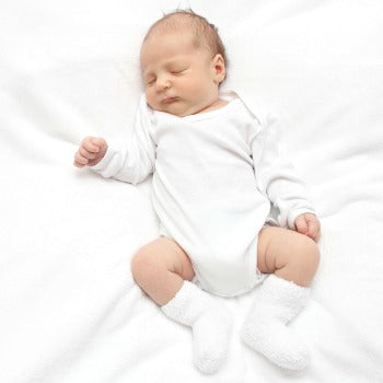 baby lying on back, one of the baby sleep positions that is most important