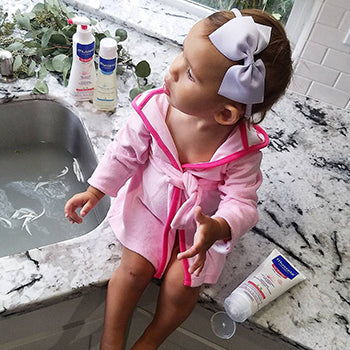 baby sitting on counter after bath