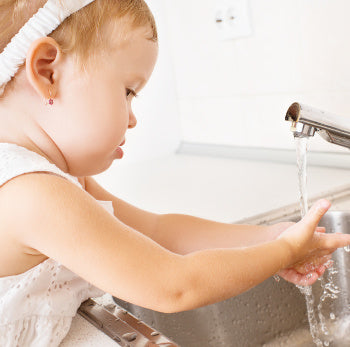 baby learning proper hand washing