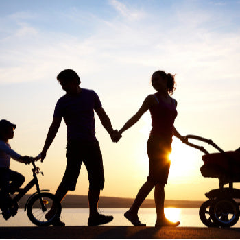 family out with mom for postpartum exercise