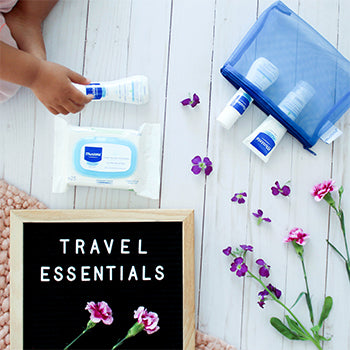 Mustela's Bebe On The Go kit that is extra handy for traveling with baby