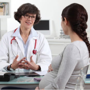 Doctor talking with mom about twin pregnancy