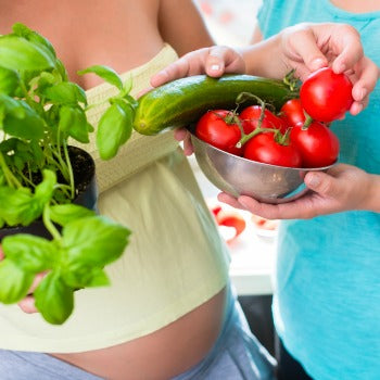 couple holding food to eat when pregnant