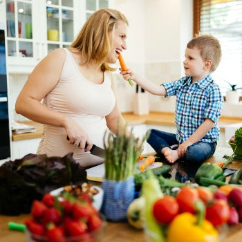 mother and child preparing foods to eat when pregnant