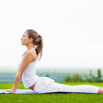 woman doing yoga during her first trimester