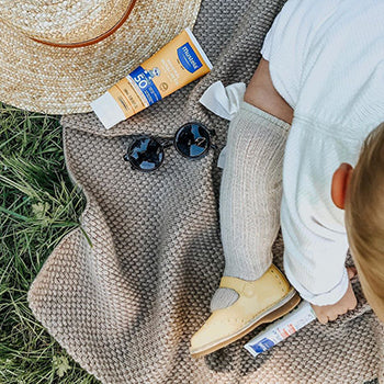 baby outside with Mustela mineral sunscreen