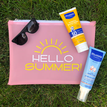 travel bag with mustela mineral sunscreen