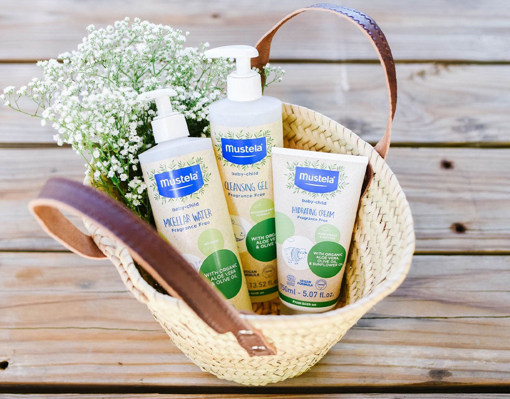 A basket full of Mustela baby skin products