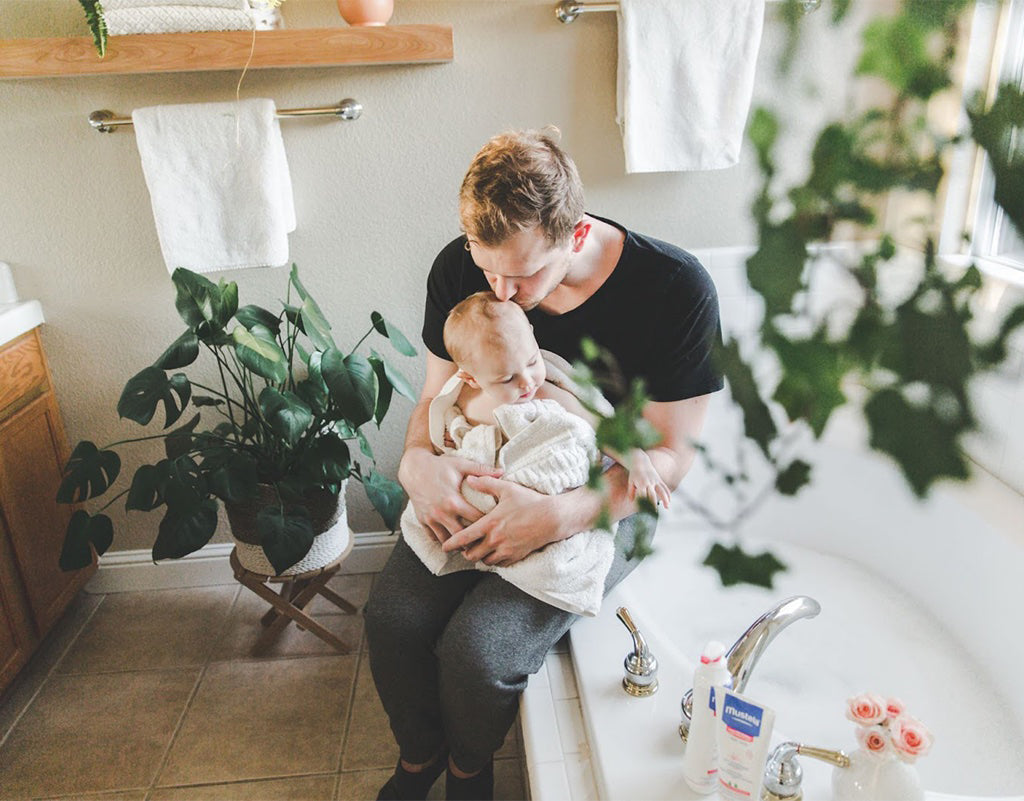 Dad holding baby after bathtime