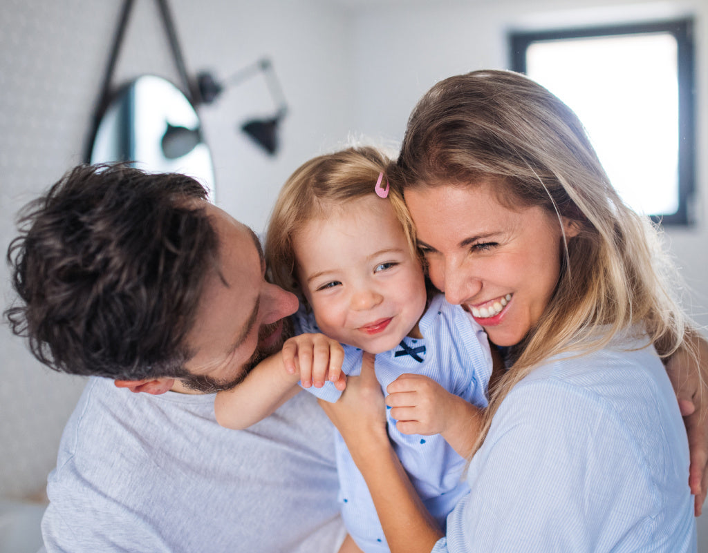 Happy family that uses natural skincare products
