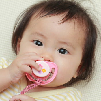baby sucking on pacifier