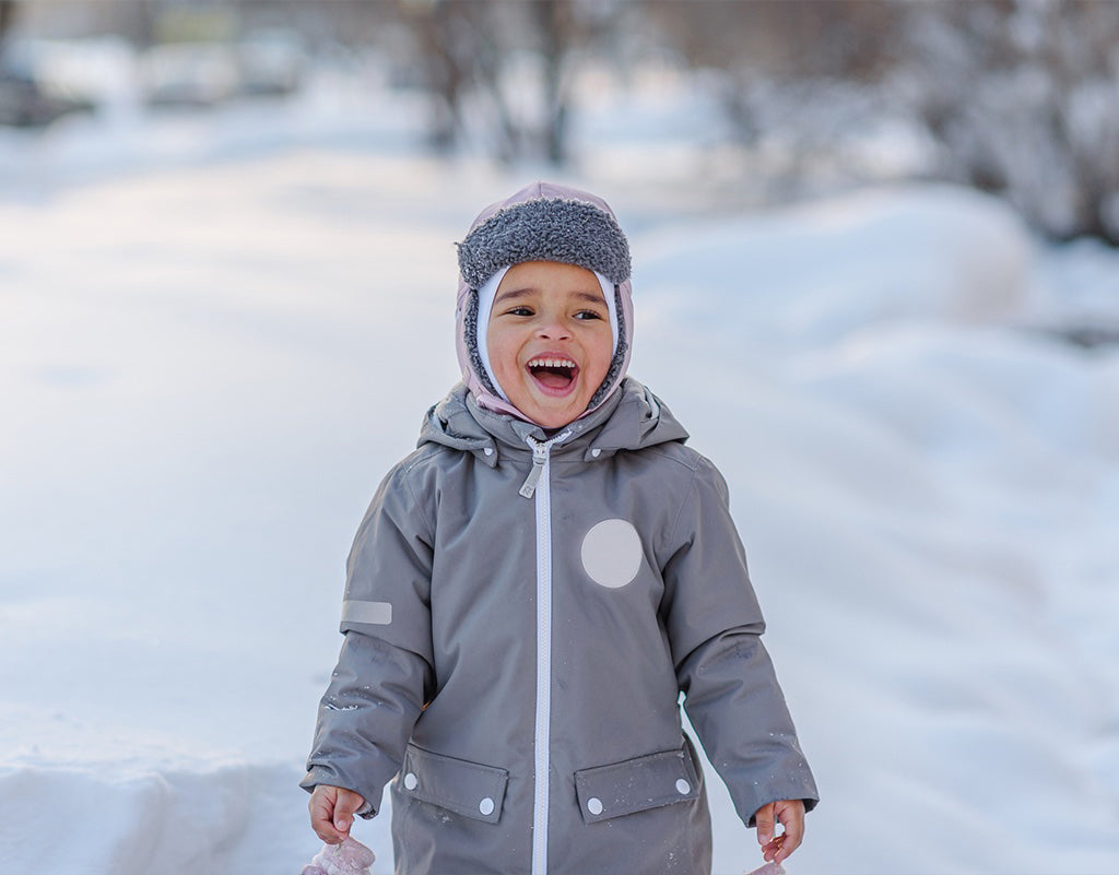 Young boy out in the snow