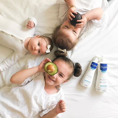 Siblings with Mustela Products
