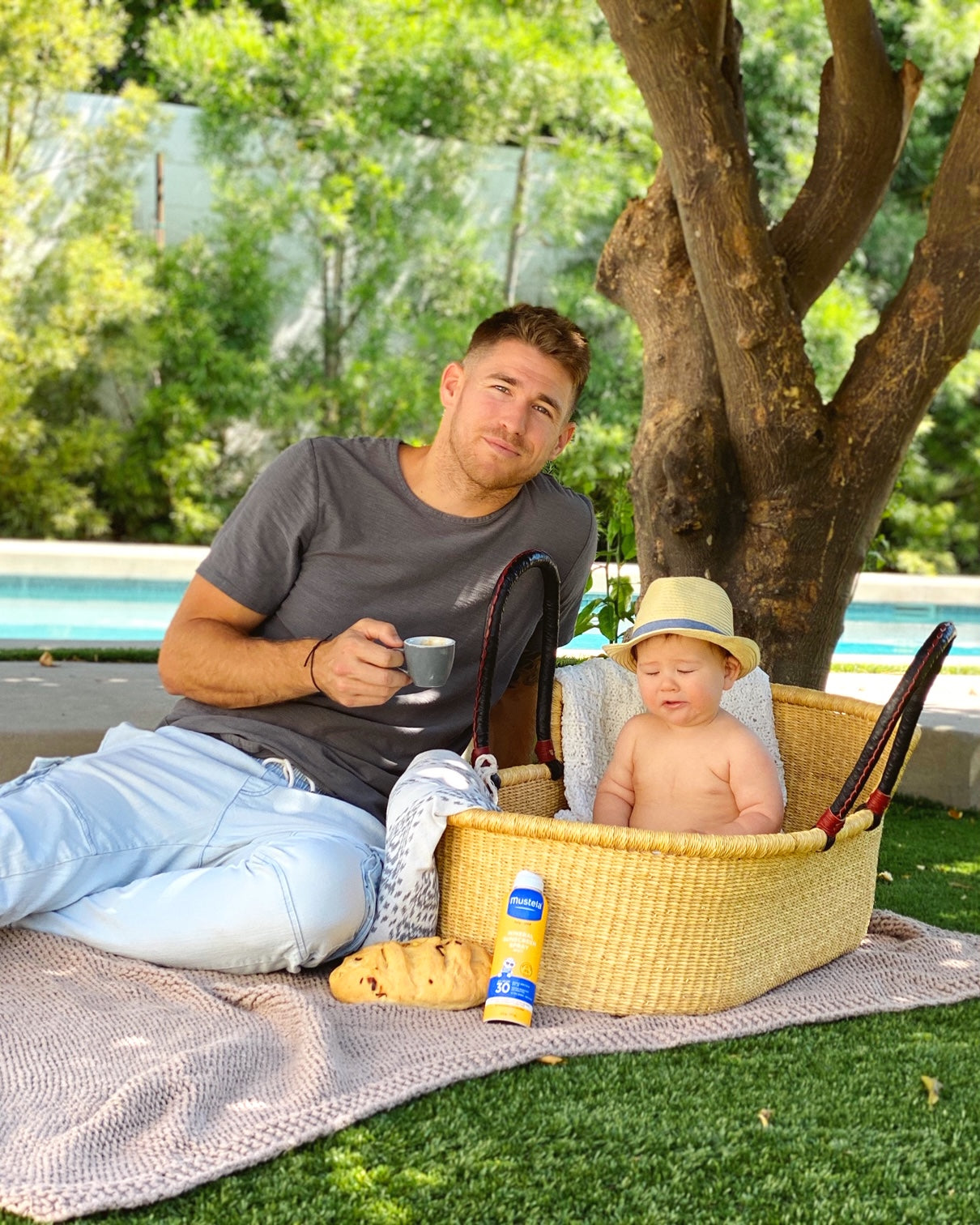 Dad having a picnic with baby wondering when do babies sit up