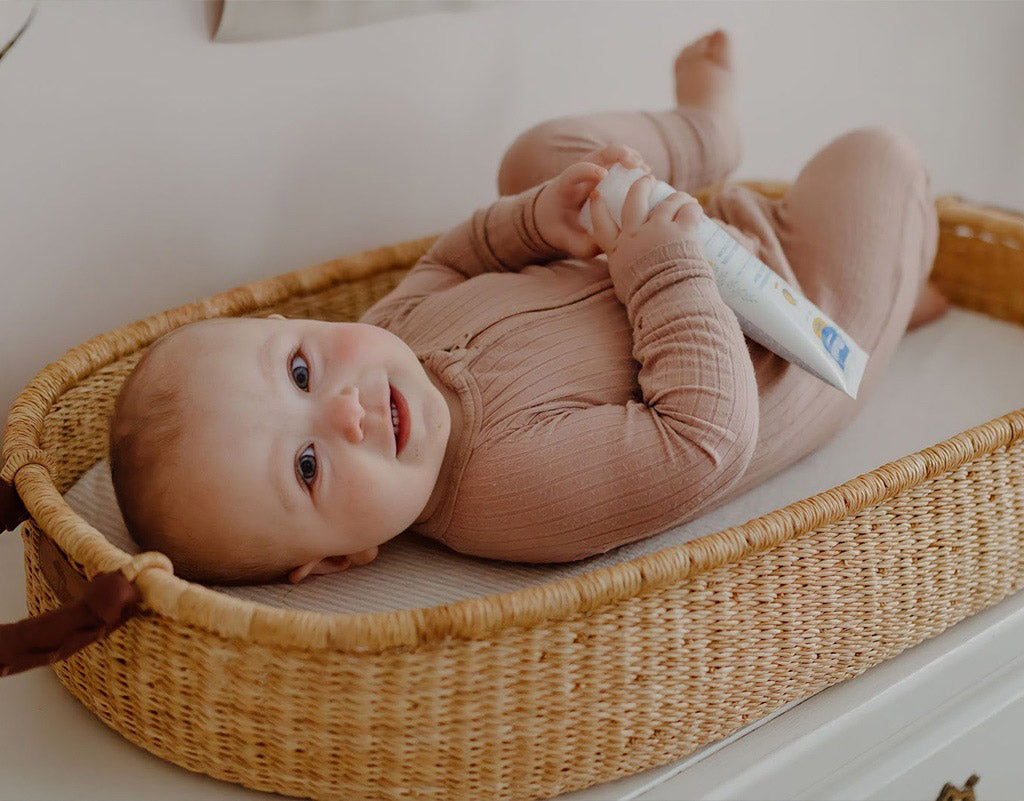 Baby laying down about to have her yeast diaper rash treated