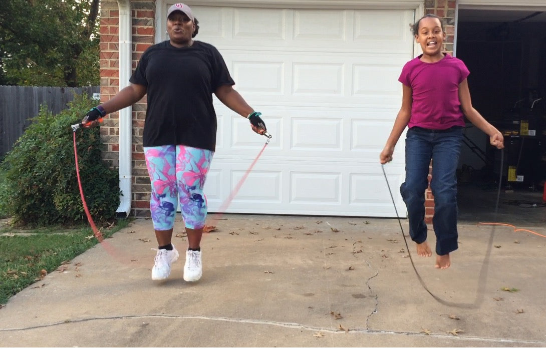 Brandy and her daughter jumping rope