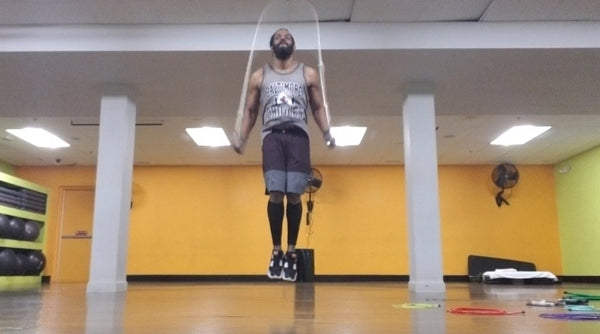 Man jumping high with a jump rope exercise