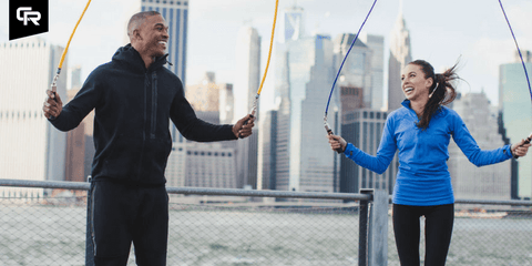 Couple working out outside having fun
