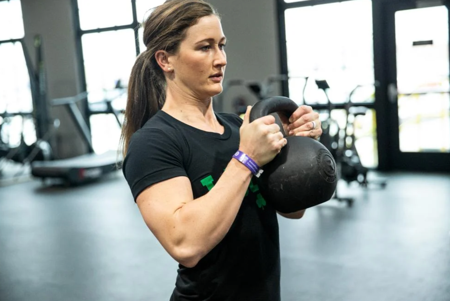 Young woman lifting a kettlebell