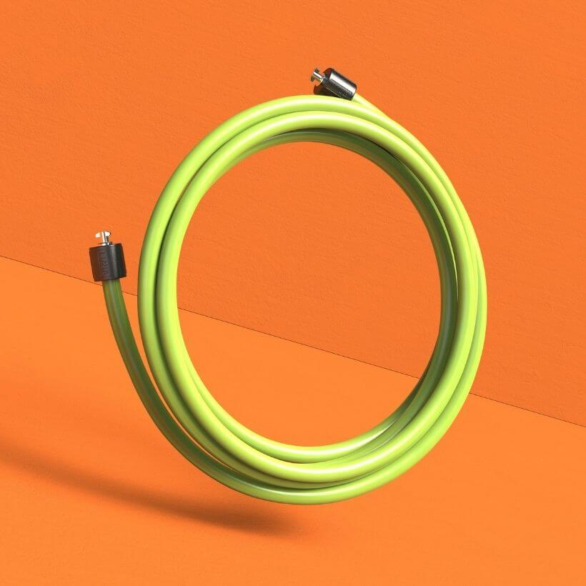 A coiled view of the 1 1/2 LB Speed Pro LE rope on an orange background