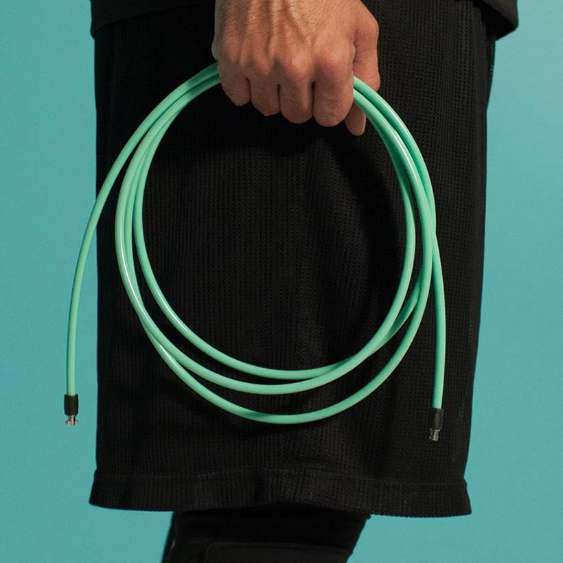 Person holding coiled 1/4 LB rope no handles
