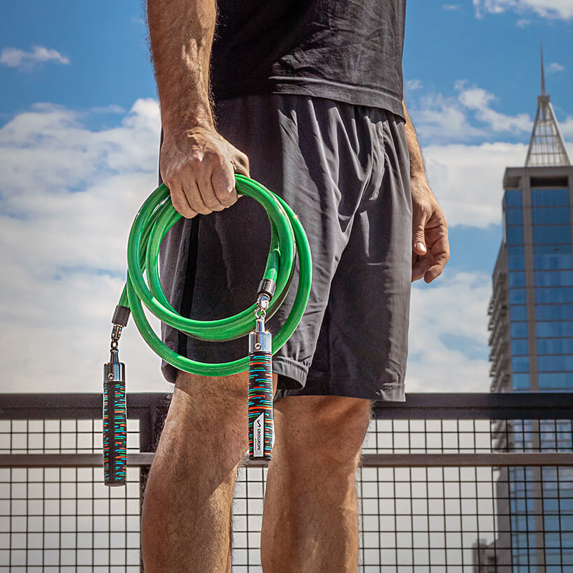 Man holding 3 LB Heavy Rope with Heavy LE Handles